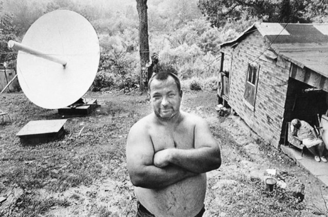 Bert Jett proudly stands in the yard of his home near Blue Creek, where he and his two brothers have installed a $7,800 satellite receiving dish so they can get better TV reception in Elkview, W.Va., July 14, 1981. The Jetts said they now can get nearly 60 stations around the globe and have their choice of four separate movie channels, as well as several Christian networks and most of the big city TV stations in this country. (Photo by AP Photo)