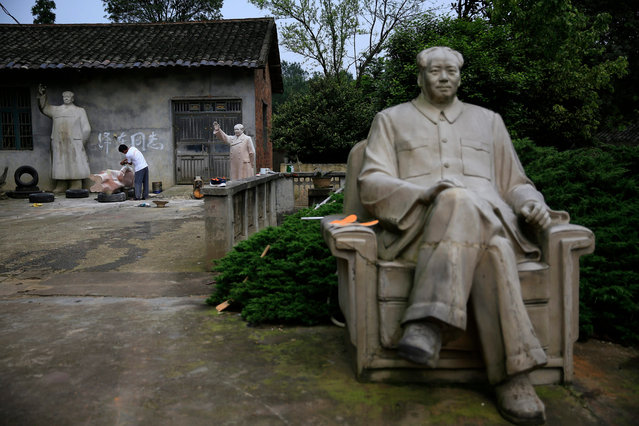 Chinese sculptor Tian Yongjun works on a Mao Zedong sculpture in his workshop in Shaoshan, Hunan Province in central China, 29 April 2016. Tian has been a sculptor making Mao statues for over 20 years. (Photo by How Hwee Young/EPA)