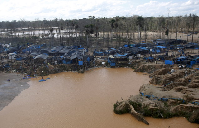 A view of an illegal gold mining camp in a zone known as Mega 14, in the southern Amazon region of Madre de Dios July 14, 2015. (Photo by Janine Costa/Reuters)
