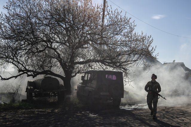 In this April 20, 2019, file photo, a Ukrainian serviceman guards a position near the front line as the conflict continues, in Marinka, Donetsk region, eastern Ukraine. Ukraine signed much-anticipated accords with separatists from the country's east, Russia and European monitors on Tuesday, October 1, 2019, that agree a local election can be held in separatist-controlled territory, paving the way for peace talks with Moscow. (Photo by Evgeniy Maloletka/AP Photo/File)