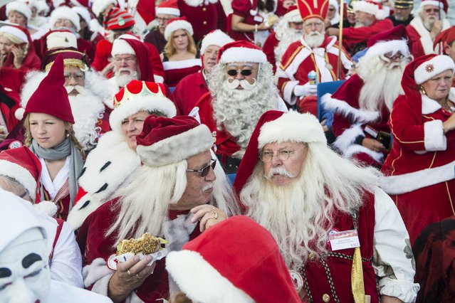 Participants take a boat tour during the World Congress of Santas in Copenhagen, Denmark, July 20, 2015. (Photo by Sara Gangsted/Reuters/Scanpix Denmark)