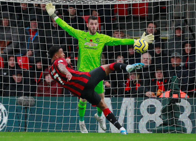 Bournemouth's Norwegian striker Joshua King scores the opening goal past Manchester United's Spanish goalkeeper David de Gea during the English Premier League football match between Bournemouth and Manchester United at the Vitality Stadium in Bournemouth, southern England on November 2, 2019. (Photo by Andrew Couldridge/Action Images via Reuters)
