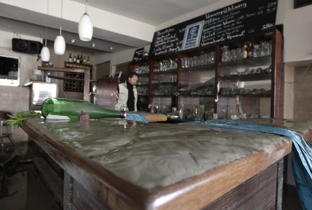 """The """"Theatercafe - Aquarium"""" is covered with mud and damaged by floods in the centre of Passau, north-east of Munich on June 4, 2013. REUTERS/Michaela Rehle"""