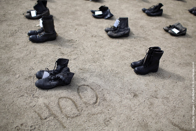 ows of combat boots that are part of the Eyes Wide Open exhibit are displayed in front of San Francisco City Hall