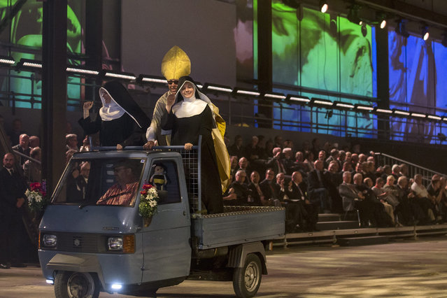 Artists perform during the opening show directed by German director Volker Hesse, on the opening day of the Gotthard rail tunnel, the longest tunnel in the world, at the fairground in Pollegio, Switzerland, Switzerland, 01 June 2016. The construction of the 57 kilometer long tunnel began in 1999, the breakthrough was in 2010. After the official opening on 01 June, the commercial opperation will commence on December 2016. (Photo by Alexandra Wey/EPA)