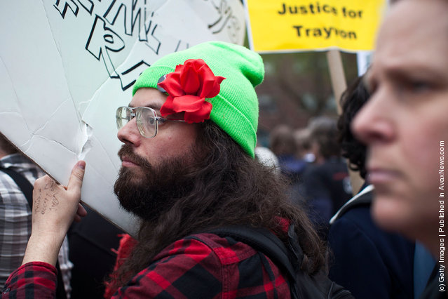 An Occupy Wall Street protester holds up a banner in Union Square at the end of a march from Zuccotti Park to Union Square