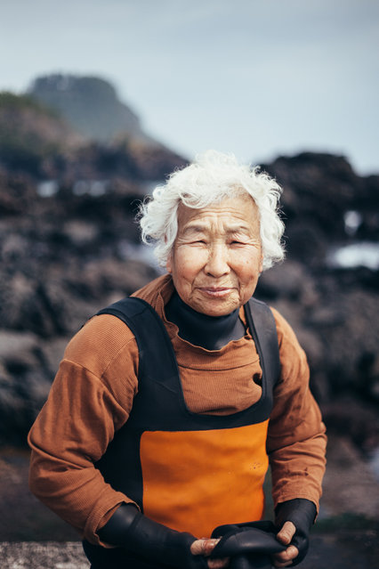 """""""The Windy Women of Jeju"""". I had recently travelled to the island of Jejudo. During my stay there, I grew more interested in the elder women on the island. Many of these women (as old as 70-80+) would dive in the rough Pacific, and dive for 6 hours to forage for seaweed, sea cucumber, squid and other sea creatures to eat & sell. My conversations with them were the most memorable moments and hope to return to capture more of their daily lives. Photo location: Korea. (Photo and caption by Angie Choi/National Geographic Photo Contest)"""