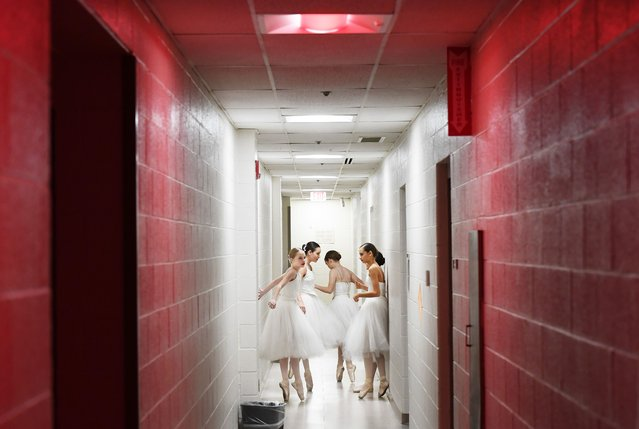 """Performers gather in a hallway before taking the stage during a Metropolitan School of the Arts production of """"The Nutcracker"""" at the Ernst Community Cultural Center in Annandale, Va. on December 8, 2019. (Photo by Matt McClain/The Washington Post)"""