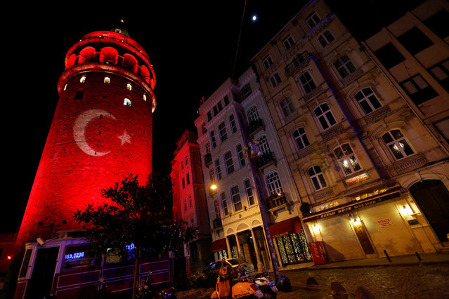 A Turkish flag is projected on the historical Galata Tower in tribute to the victims of Saturday's blasts, in Istanbul, Turkey, early December 12, 2016. (Photo by Murad Sezer/Reuters)