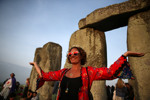 A woman at the stones of Stonehenge monument on the summer solstice near Amesbury, Britain on June 21, 2017. (Photo by Neil Hall/Reuters)