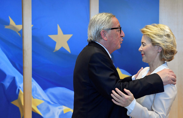 Outgoing president of the European Commission Jean-Claude Juncker (L) welcomes German Defence Minister and newly-appointed EU Commission Chief Ursula von der Leyen, on July 23, 2019, 2019 in Brussels. (Photo by John Thys/AFP Photo)