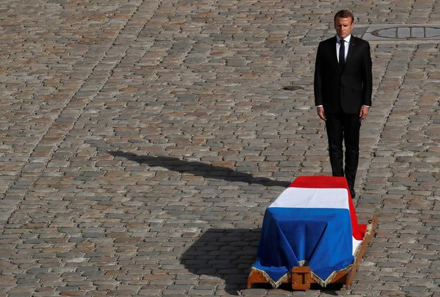 French President Emmanuel Macron stands in front of the coffin of former French president Jacques Chirac during a military tribute at the Invalides (Hotel des Invalides) in Paris on September 30, 2019. Former French President Jacques Chirac died on September 26, 2019 at the age of 86. (Photo by Gonzalo Fuentes/Reuters)