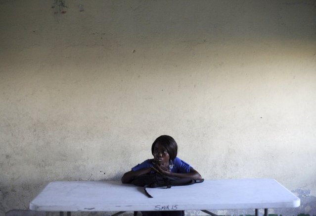 A woman waits for electoral materials to arrive at a polling station in Port-au-Prince, Haiti, August 9, 2015. Haitians voted Sunday for the first time in four years in a test of stability for an impoverished country continually rocked by political turmoil. (Photo by Andres Martinez Casares/Reuters)