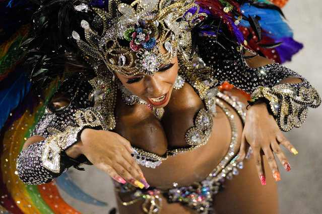 A dancer of Beija Flor samba school parades during carnival celebrations at the Sambadrome in Rio de Janeiro,on February 20, 2012