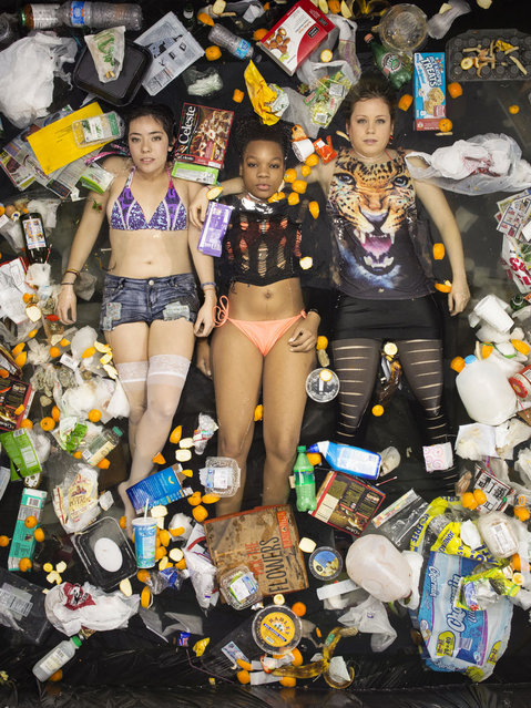 Lya, Whitney and Kathrin surrounded by seven days of their own rubbish in Pasadena, California. If you've never thought about how much rubbish you throw away an honest photographic series will open your eyes.(Photo by Gregg Segal/Barcroft Media)