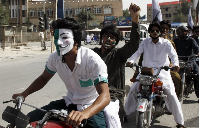 Youths ride motorcycles and celebrate during at a national day rally during the country's 69th Independence Day in Quetta, Pakistan, August 14, 2015. (Photo by Naseer Ahmed/Reuters)