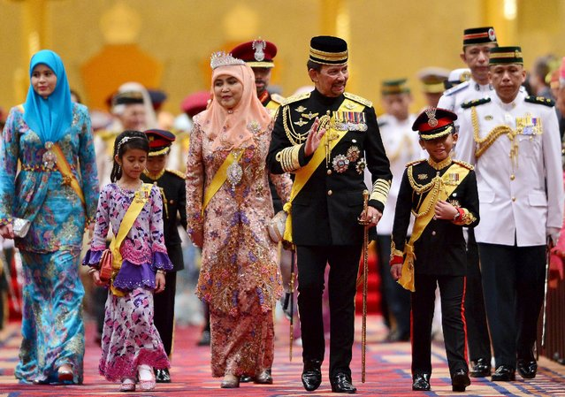 (Front row L-R) Brunei's Crown Princess Sarah, Princess Ameerah, Queen Saleha, Sultan Hassanal Bolkiah and Prince Abdul Wakeel leave the throne room during the Sultan's 69th birthday celebration in Nurul Iman palace in Bandar Seri Begawan, Brunei, August 15, 2015. (Photo by Ahim Rani/Reuters)