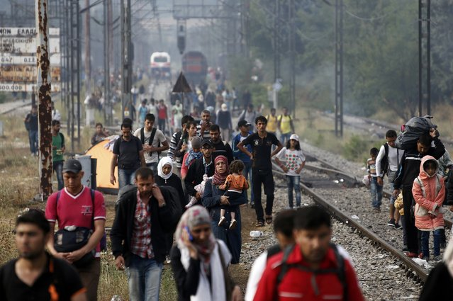 Migrants and refugees make their way towards the Greek-Macedonian border, near the village of Idomeni, August 22, 2015. (Photo by Yannis Behrakis/Reuters)