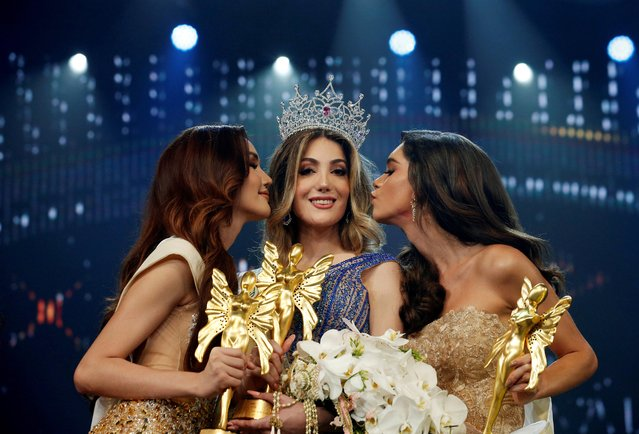 Thailand's Ruethaipreeya Nuanglee and Brazil's Ariella Moura kiss Mexico's Valentina Fluchaire after she won the crown at the Miss International Queen 2020 transgender beauty pageant in Pattaya, Thailand on March 7, 2020, at what is billed as the world's biggest transgender pageant. (Photo by Soe Zeya Tun/Reuters)