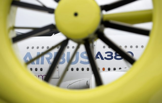 An Airbus A380 is seen through an helicopter engine blades at the Farnborough International Airshow in Farnborough, Britain, 12 July 2016. (Photo by Hannah Mckay/EPA)