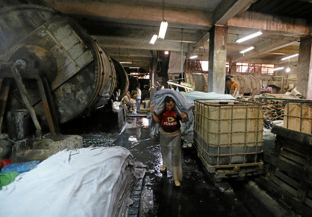 "A labourer works in a leather tannery where Co-founders of a local brand ""Okhtein"", sisters Aya and Mounaz Abdelraouf purchase leather in Cairo, Egypt May 26, 2016. (Photo by Mohamed Abd El Ghany/Reuters)"