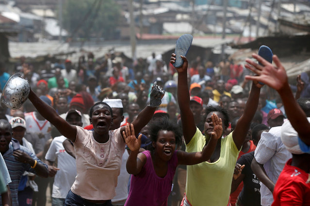 Supporters of an opposition leader Raila Odinga celebrate in Mathare slum after President Uhuru Kenyatta's election win was declared invalid by a court in Nairobi, Kenya, September 1, 2017. (Photo by Siegfried Modola/Reuters)
