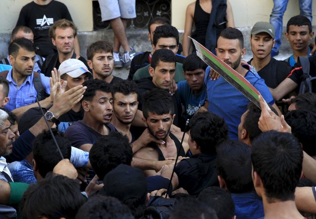 A group of migrants try to make their way through the crowd to the Keleti (Eastern) Railway Terminus in Budapest, Hungary, September 2, 2015. (Photo by Bernadett Szabo/Reuters)