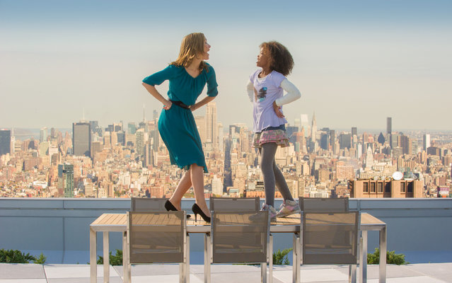 """This image released by Columbis Pictures shows Rose Byrne, left, and Quvenzhané Wallis in a scene from """"Annie"""", 2013. (Photo by Barry Wetcher/AP Photo/Columbia Pictures/Sony)"""