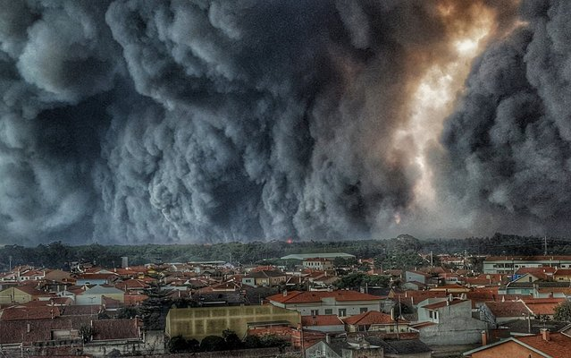 Fire over Vieira de Leiria, Portugal, on October 16, 2017 as a series of deadly wildfires broke out across Spain and Portugal as the approach of Hurricane Ophelia whipped up strong winds that fanned the flames. (Photo by Helio Madeiras/News Pictures)