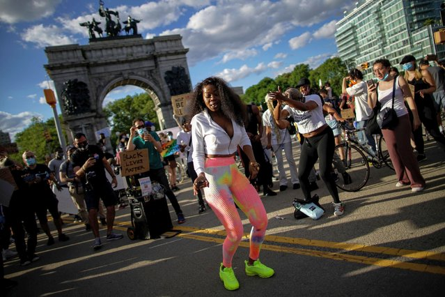 Demonstrators interact during a protest against racial inequality in the aftermath of the death in Minneapolis police custody of George Floyd, in front of the at Grand Army Plaza in the Brooklyn borough of New York City, New York, U.S. June 7, 2020. (Photo by Eduardo Munoz/Reuters)