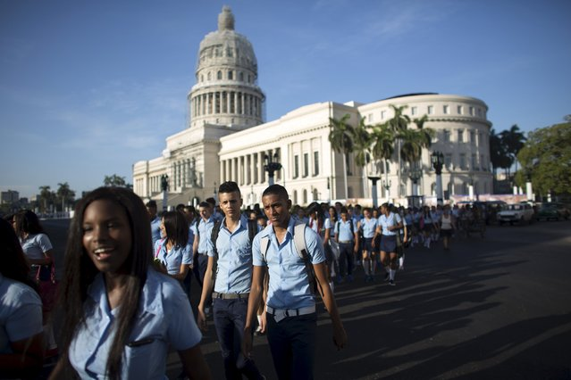 Pre-university students walk in downtown Havana to mark the first day of class for the 2015-2016 course, September 1, 2015. Universal free education is one of the pillars of the socialist society built in Cuba since Fidel Castro's 1959 revolution. (Photo by Alexandre Meneghini/Reuters)
