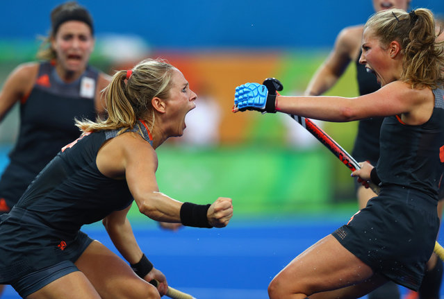 Kitty van Male of Netherlands (l) celebrates with Xan de Waard (r) after scoring the equalising goal to make score 1-1 during the Women's Gold Medal Match against the Netherlands on Day 14 of the Rio 2016 Olympic Games at the Olympic Hockey Centre on August 19, 2016 in Rio de Janeiro, Brazil. (Photo by Tom Pennington/Getty Images)