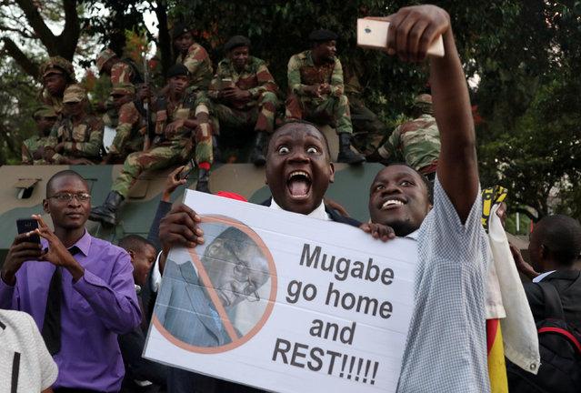 Zimbabweans celebrate after President Robert Mugabe resigns in Harare, Zimbabwe November 21, 2017. (Photo by Philimon Bulawayo/Reuters)