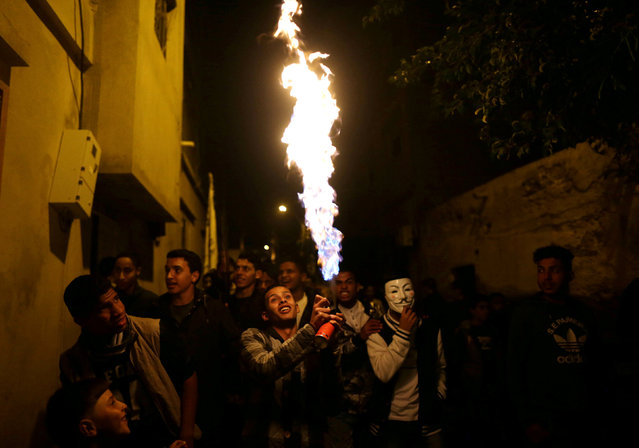 A man uses a torch burner during a procession to celebrate the birth of Prophet Mohammad in Benghazi, Libya November 29, 2017. (Photo by Esam Omran Al-Fetori/Reuters)