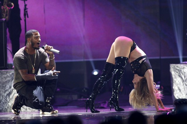 Trey Songz (L) performs with a dancer during the second night of the 2015 iHeartRadio Music Festival at the MGM Grand Garden Arena in Las Vegas, Nevada September 19, 2015. (Photo by Steve Marcus/Reuters)