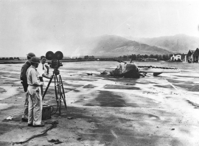 10th December 1941:  Wreckage of a US Navy amphibian plane being photographed. It was destroyed during the nearby Pearl Harbour (Pearl Harbor) attack.  (Photo by Keystone/Getty Images)