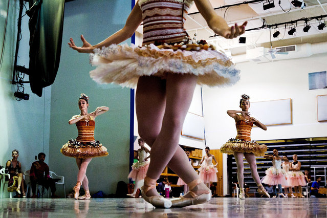 "Cast members of ""The Nutcracker"" rehearse at Miami City Ballet in Miami Beach, Fla. on November 10, 2017. Isabel and Ruben Toledo redesigned the classic production to reflect the spirit – and temperature – of Miami. (Photo by Scott McIntyre/The New York Times)"