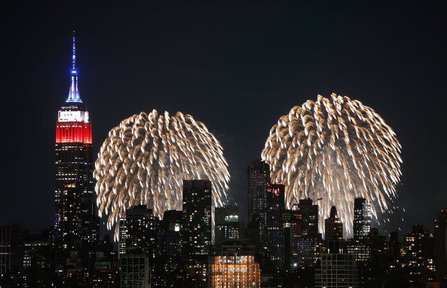 Fireworks explode next to the Empire State Building on the first of six nights of the Macy's Fourth of July fireworks shows in New York City on June 29, 2020 as seen from Jersey City, New Jersey. (Photo by Gary Hershorn/Getty Images)
