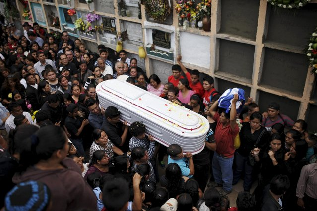 People participate in the funeral of members of the Sandoval family, mudslide victims in Santa Catarina Pinula, on the outskirts of Guatemala City, October 4, 2015. (Photo by Josue Decavele/Reuters)