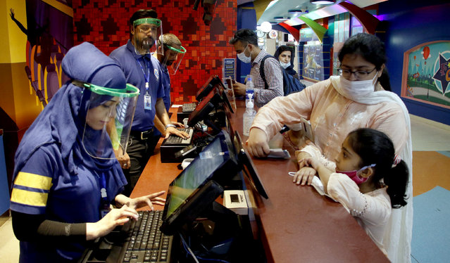 Families visit amusement area at a mall after government announced it would be lifting most of the country's remaining coronavirus restrictions in Islamabad, Pakistan, 08 August 2020. All restaurants and parks cinemas will be allowed to re-open from 10 August 2020. (Photo by Sohail Shahzad/EPA/EFE/Rex Features/Shutterstock)
