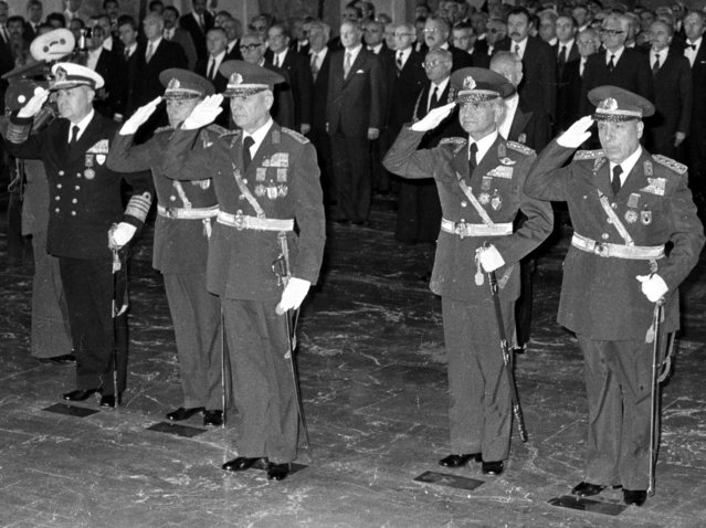 In this October 29, 1980 file photo, the leaders of Sept. 12 military coup, from left to right, Adm. Nejat Tumer, Gen. Nurettin Ersin, Gen. Kenan Evren, Gen. Tahsin Sahinkaya and Gen. Sedat Celasun stand during a ceremony at the mausoleum of the founder of modern Turkey, Kemal Ataturk, in Ankara, Turkey. (Photo by Burhan Ozbilici/AP Photo)