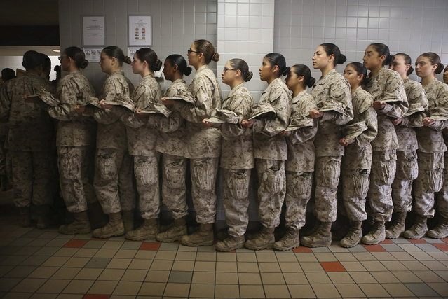 Female Marine recruits stand in line before getting lunch in the chow hall during boot camp on February 26, 2013 at MCRD Parris Island, South Carolina. Female enlisted Marines have gone through recruit training at the base since 1949. About 11 percent of female recruits who arrive at the boot camp fail to complete the training, which can be physically and mentally demanding. On January 24, 2013 Secretary of Defense Leon Panetta rescinded an order, which had been in place since 1994, that restricted women from being attached to ground combat units. (Photo by Scott Olson/AFP Photo)