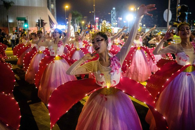 Performers take part in a street parade to mark the Lunar New Year celebrations for the Year of the Dog in Hong Kong on February 16, 2018. (Photo by Anthony Wallace/AFP Photo)