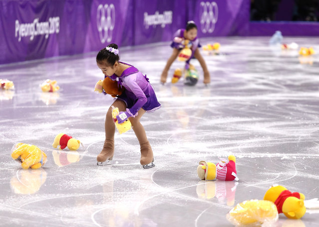 Skaters pick up gifts thrown to the ice for Yuzuru Hanyu of Japan during the Men's Single Skating Short Program at Gangneung Ice Arena on February 16, 2018 in Gangneung, South Korea. (Photo by Maddie Meyer/Getty Images)