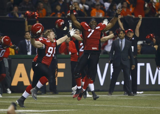 Calgary Stampeders' Junior Turner (7) celebrates with teammates after Calgary defeated the Hamilton Tiger Cats in the CFL's 102nd Grey Cup football championship in Vancouver, British Columbia, November 30, 2014. (Photo by Mark Blinch/Reuters)
