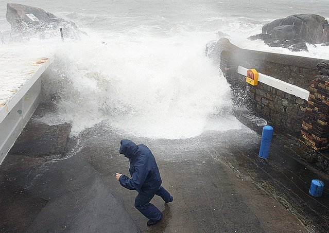 Heavy rain and bad weather conditions at the forty foot, Sandycove in Dublin this morning, March 22, 2013. (Photo by Stephen Collins/Collins Photos)