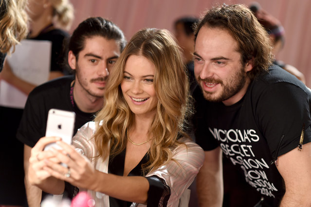 Victoria's Secret model Behati Prinsloo poses with stylists seen backstage prior the 2014 Victoria's Secret Fashion Show on December 2, 2014 in London, England. (Photo by Dimitrios Kambouris/Getty Images for Victoria's Secret)