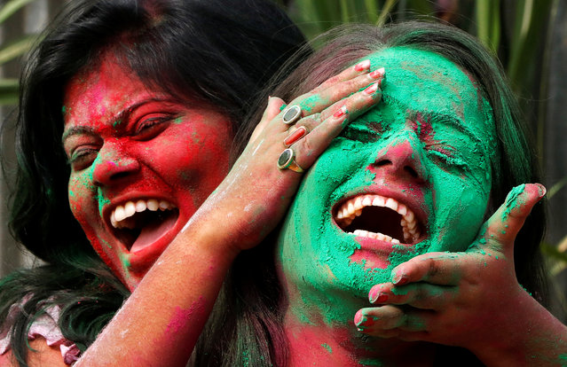 A college student smears a friend with coloured powder during Holi celebrations in Agartala, India March 1, 2018. (Photo by Jayanta Dey/Reuters)