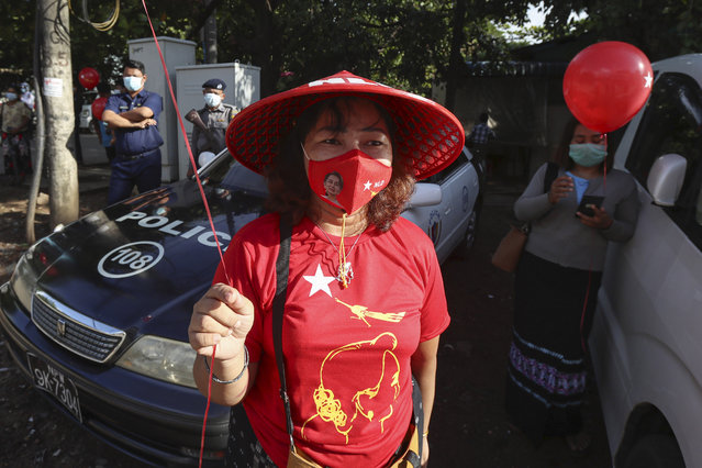 A member of Myanmar leader Aung San Suu Kyi's National League for Democracy (NLD) party attends a ceremony to display billboard of their candidates for upcoming election at the party's regional office Tuesday, September 8, 2020, in Yangon. Election campaign period began Tuesday for November 8 general election. (Photo by Thein Zaw/AP Photo)