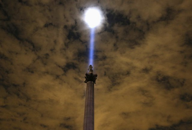 Light is beamed into the sky from Trafalgar Square to mark the 100th anniversary of the outbreak of World War One, in London, in this August 4, 2014 file photo. (Photo by Paul Hackett/Reuters)